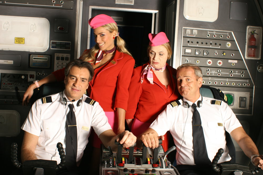 "Jessica and the cast of network sitcom ""Pilots"" in a promo shot for the series"