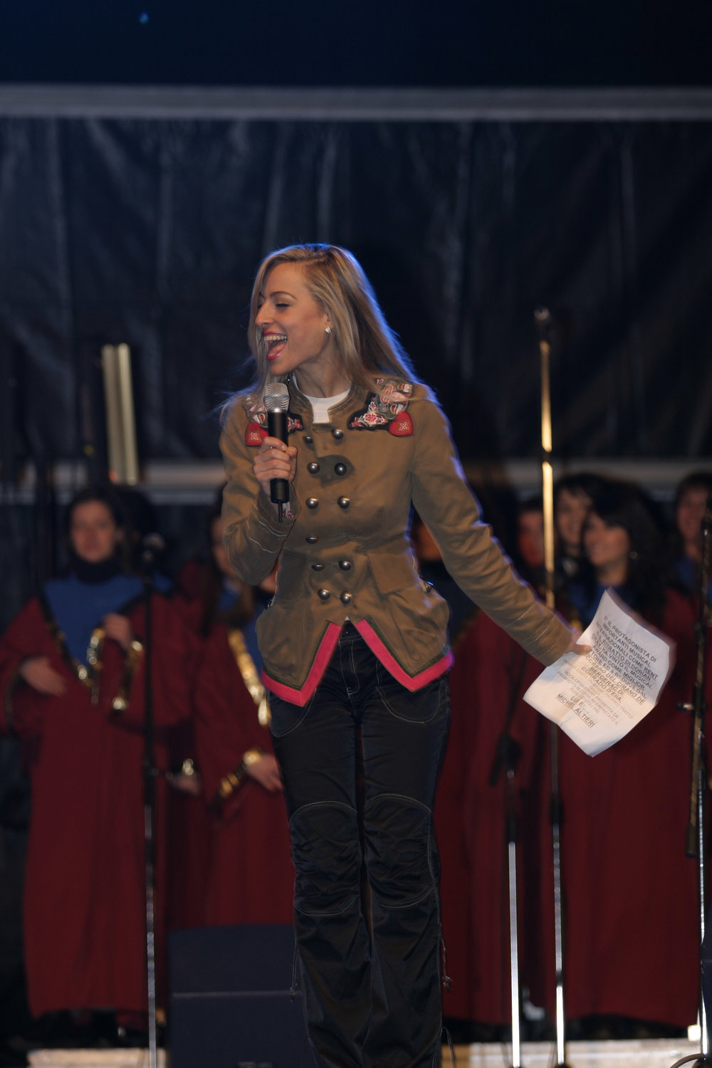 Jessica onstage hosting Milan's outdoor Christmas concert in the Duomo Plaza