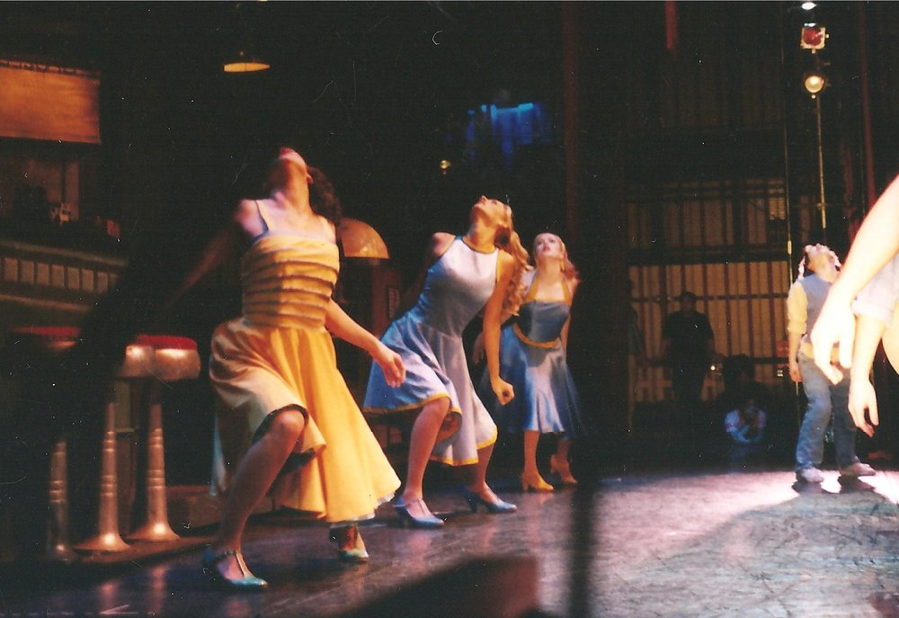 "Jessica, center, onstage in a scene from the World Tour of ""West Side Story"""