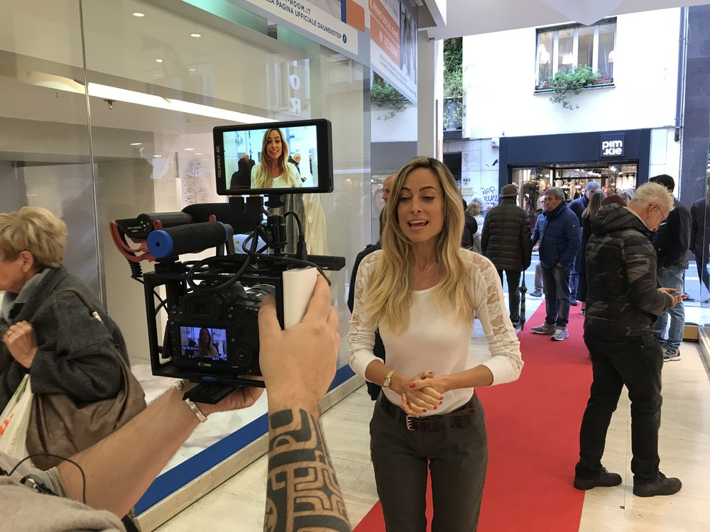 Jessica hosting a live-streaming broadcast during a promotional event for a brand partner