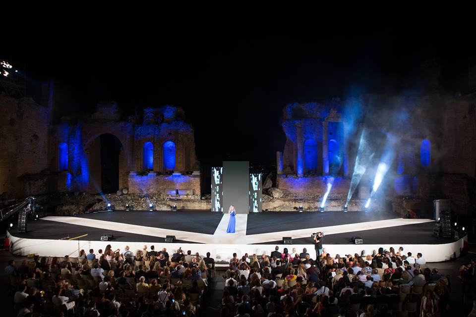 Jessica onstage hosting gala evening at Taormina's celebrated ancient Greek amphitheatre