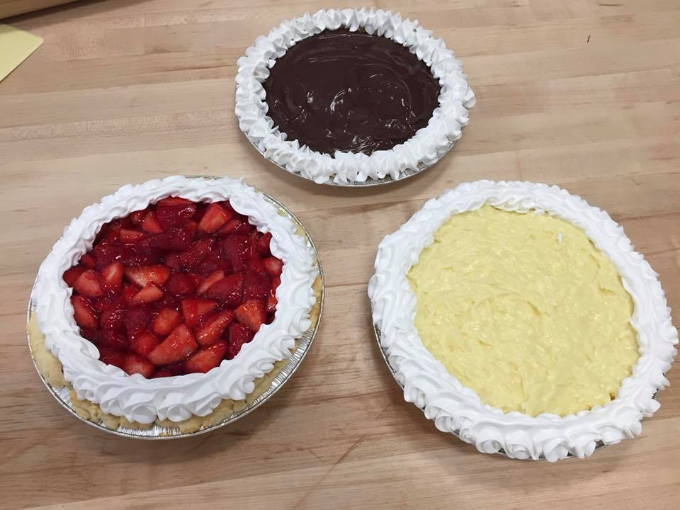 Strawberry, chocolate creme, and coconut creme pies