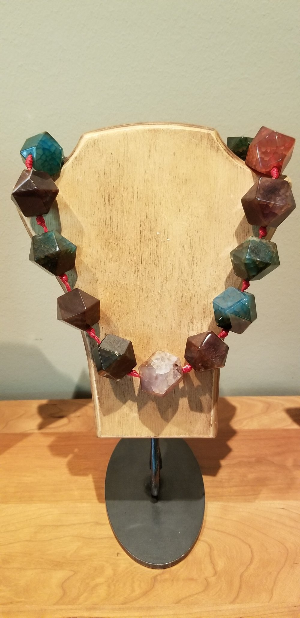 Hand-carved, polished natural stone necklace