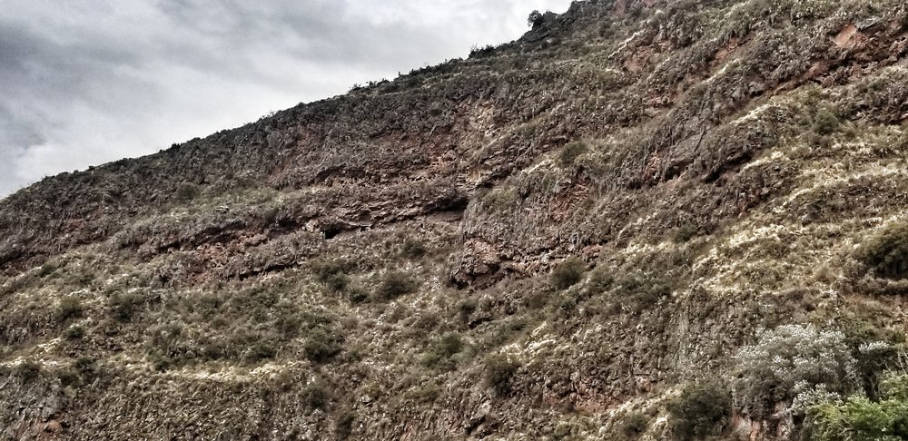 If you look closely you will see holes in the side of the mountain which is where the bodies were buried, many with wealth they had acquired in their lifetime. Grave robbers have been scouring these hills for years looking for treasure so most of these graves are now empty.