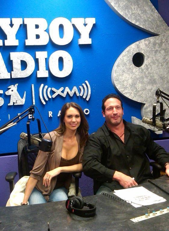"""Holli & Michael - Television and radio personalities Holli & Michael are experts in the fields of love, relationships and what it takes to feel, as well as, be sexy! They provide a forum for anyone and everyone to ask questions in a safe non-judgemental environment.Hosts of Playboy Radio'sSWING with Holli & Michael, the couple shares their experiences and gives advice to millions of listeners every week.They are the go-to experts for couples, single men and single women looking to experience a happier healthier sexier relationship, as well as, what it's like to be voyeurs, exhibitionists, or to simply """"dip their toes into the Swinging pool.""""http://holliandmichael.com/"""