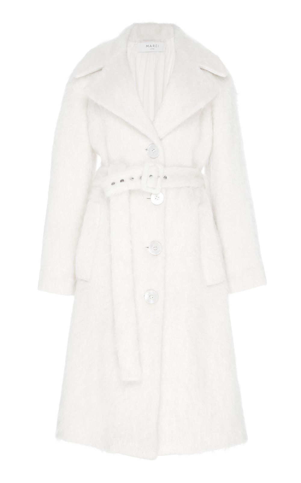 Ursinia Coat - IVORY  Sharply cut in a slight A-lined shape, this coat is incredibly elegant. Made from a unique Wool blend, it features a fluffy texture and wide notched lapels. Matching belt defines the waistline, while creating a highly flattering silhouette.