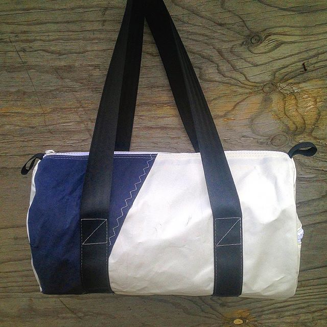Simply stylish - the 'Admiral' Jet Stream Bag features original navy canvas feature and zig-zag stitching. The ends are a contrasting crisp white vinyl.  All fabrics diverted from landfill. All hardware UV resistant and marine grade.  #leavingonajetplane#holiday#longweekend#easter#tough#recycle#upcycle#ecofashion#discovertasmania#sail#yacht#surf#watersports#divertedfromlandfill#zerowaste#reuse