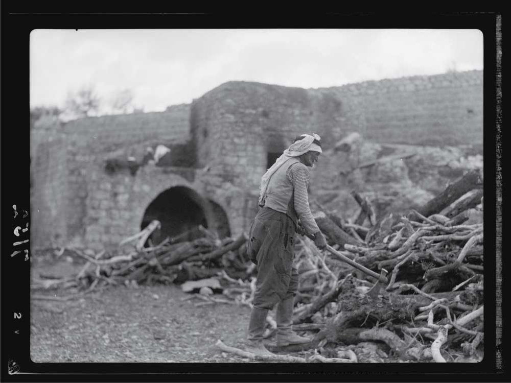 A-hewer-of-wood-in-Palestine.-Chopping-olive-wood.jpg