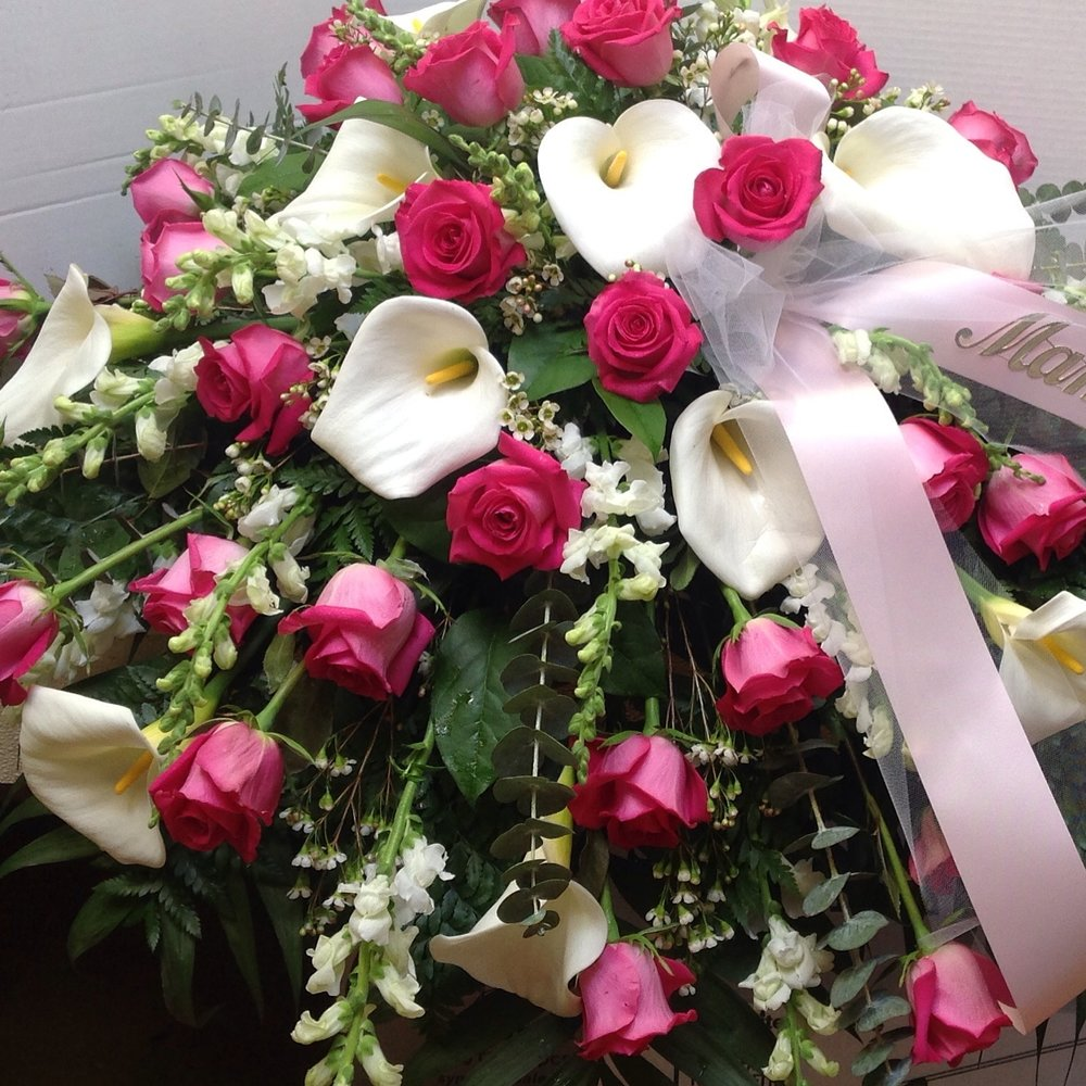 Sympathy lollipops roses florist for a memorial wake or funeral service we offer a wide selection of flower arrangements from casket covers baskets sprays and specialty pieces izmirmasajfo