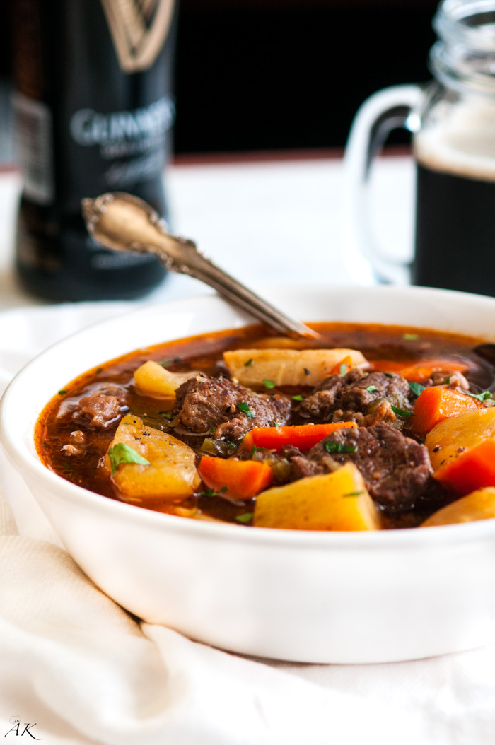 Slow Cooker Guinness Beef Stew - Recipe and photos via Aberdeen's KitchenIngredients //2 tablespoons olive oil1 ½ pounds lean Redhouse grass-fed, grass-finished Beef Stew Meat1 teaspoon sea salt1 teaspoon ground black pepper2 tablespoons flour or cornstarch4 large Yukon golden potatoes or sweet potatoes, diced2 large carrots, peeled and diced into 1-inch pieces2 large parsnips, peeled and diced into 1-inch pieces½ large yellow onion2 cloves garlic, minced1 tablespoon tomato paste4 cups Redhouse Beef Bone Broth11.2 fluid ounce bottle of Guinness Extra StoutCoarse salt and black pepper to taste