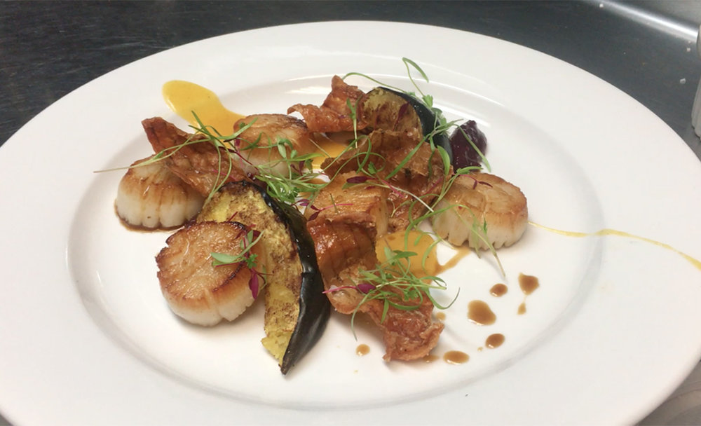 This delicious dish is made of seared scallops and Thanksgiving leftovers.