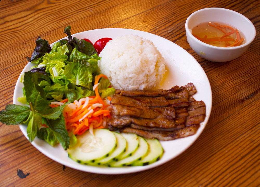 Grilled pork rice entree served with Vietnamese Vinaigrette dressing