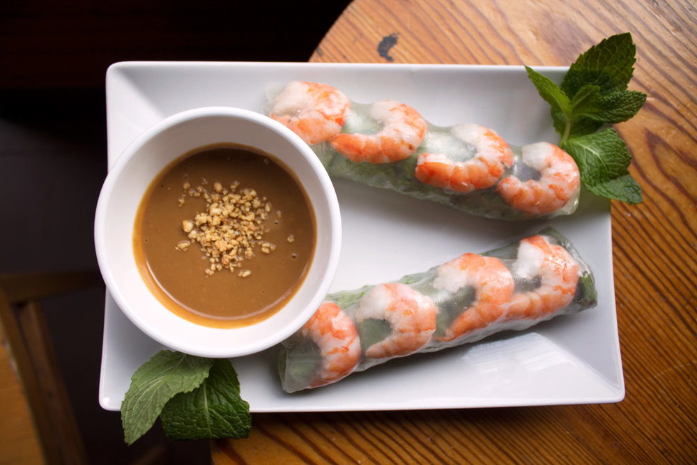 Shrimp summer roll wrapped in rice paper with hoisin sauce