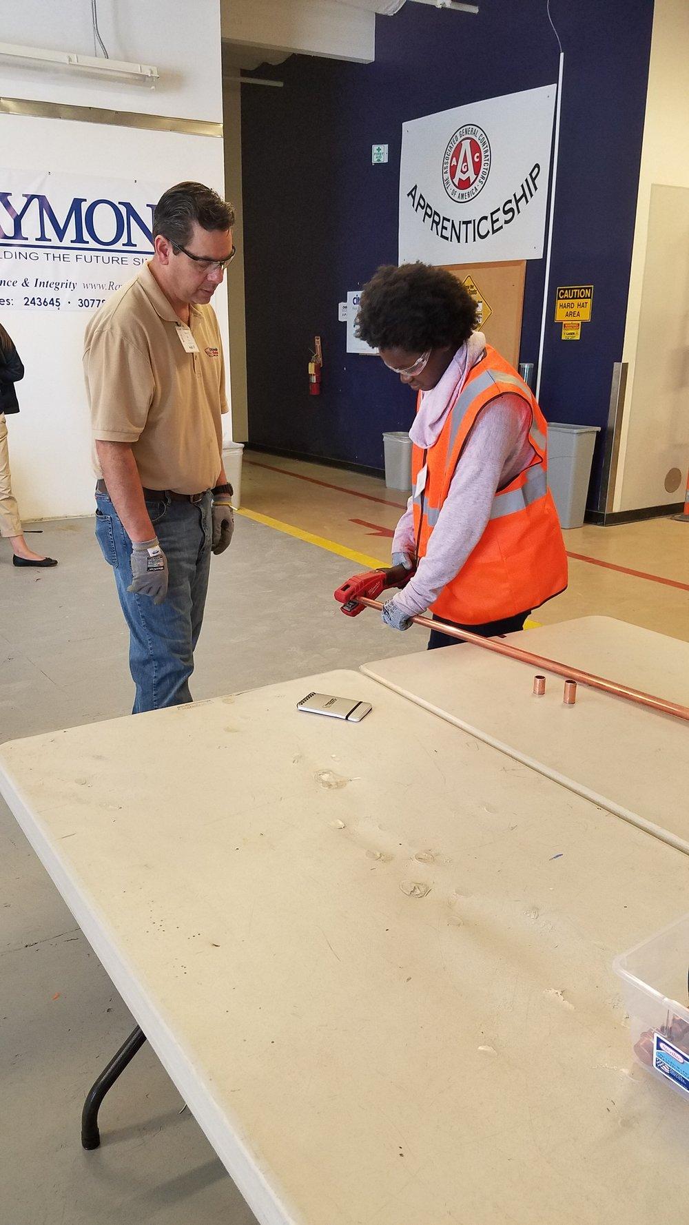 Apprentice Cutting Pipe.JPG