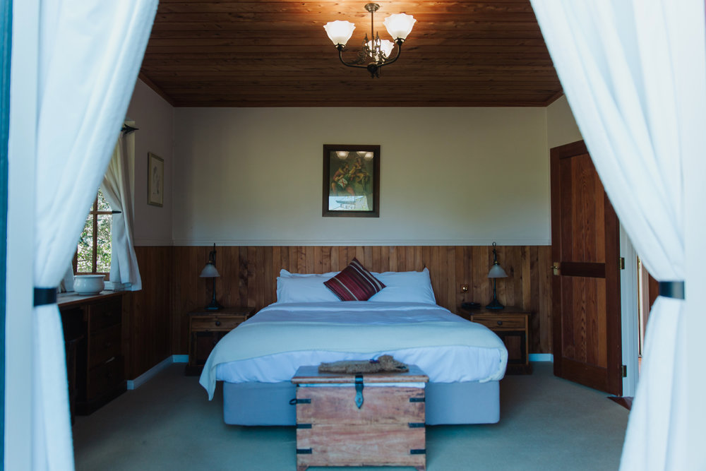Your accomodation awaits you in one of seven settler-style cottages at the Vineyard Cottages.