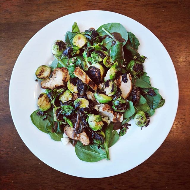 Confession: I may or may not have had cereal with a side of pinto beans last week for lunch. 😁 I'm a sacrificial eater! Ha!  So this week I'm upping my game and eating something green🌱. This brussel sprout salad took less than 10 minutes. Just a little olive oil and salt and pepper to brown them right up. Toss with fresh spinach, leftover chicken, gorgonzola, and a little balsamic dressing.  Now that's lunch! 👏👏👏 #heathyfood #healthyish #betterthancereal #nomnom
