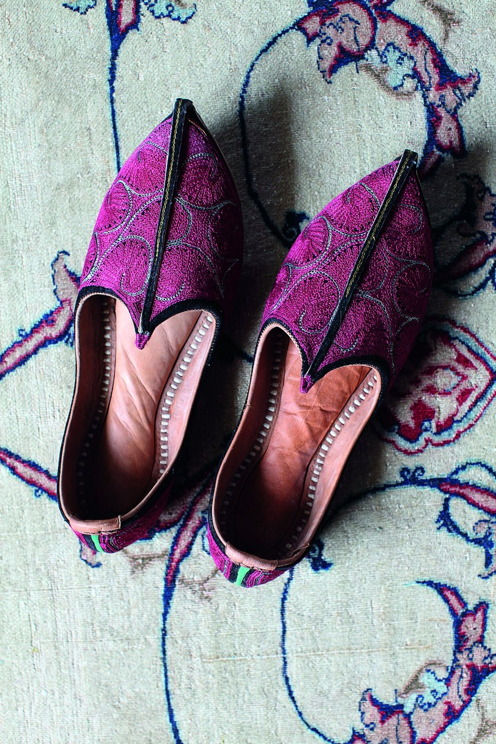Mojaris slippers were introduced to India by Mughals in the sixteenth century. The soles are usually hard leather, whereas the uppers are often elaborately embroidered