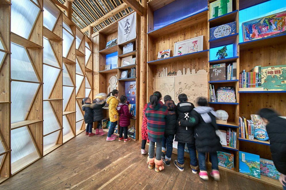 The inside of the house was warm. Every wall was made from books, endless coloured shelves stacked with books about many different subjects, real and imaginary.