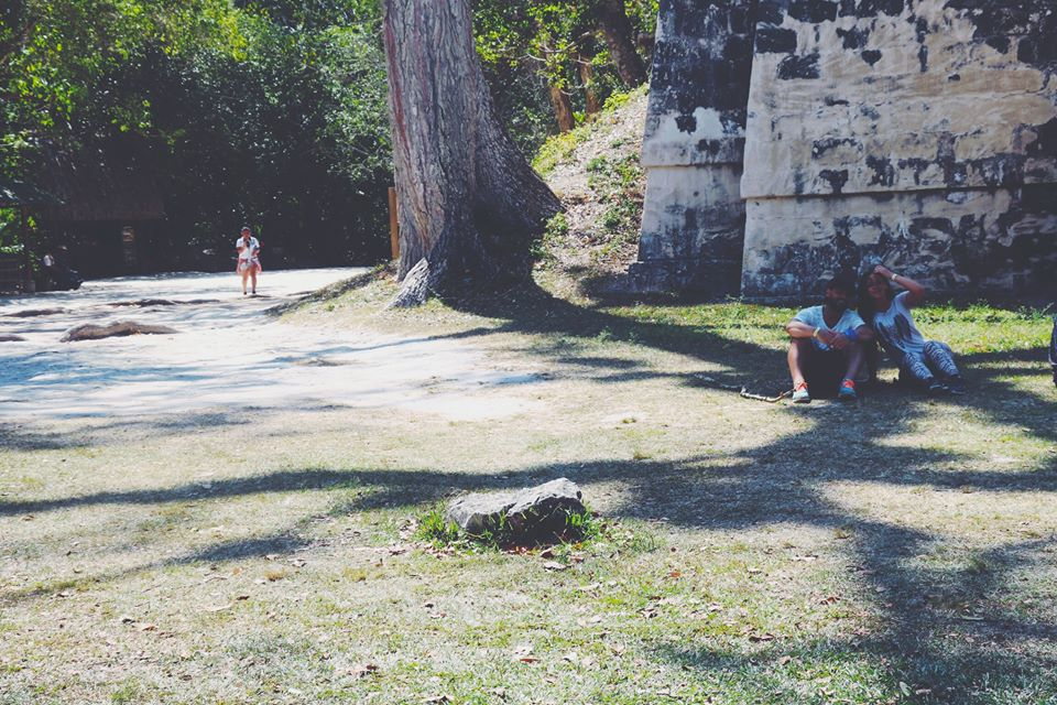 carla and moh in the shade tikal flores guatemala mayan tours mayan ruins backpacking carla maria bruno travel blogger vlogger influencer.jpg