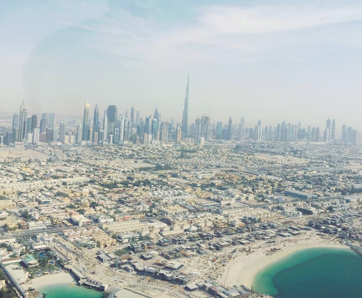 down town dubai from the sky dubai helicopter tour fly high dubai what to do in dubai carla maria bruno travel blogger vlogger influencer collaboration.png