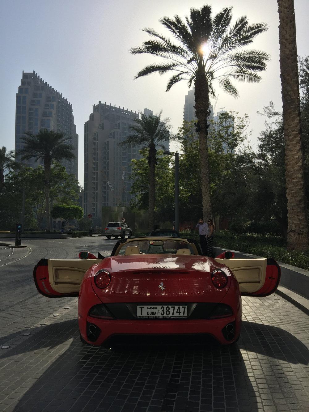 parked out side th burj with ferrari dubai burj khalifa room travel blogger influencer vlogger carla maria bruno advantures.jpg