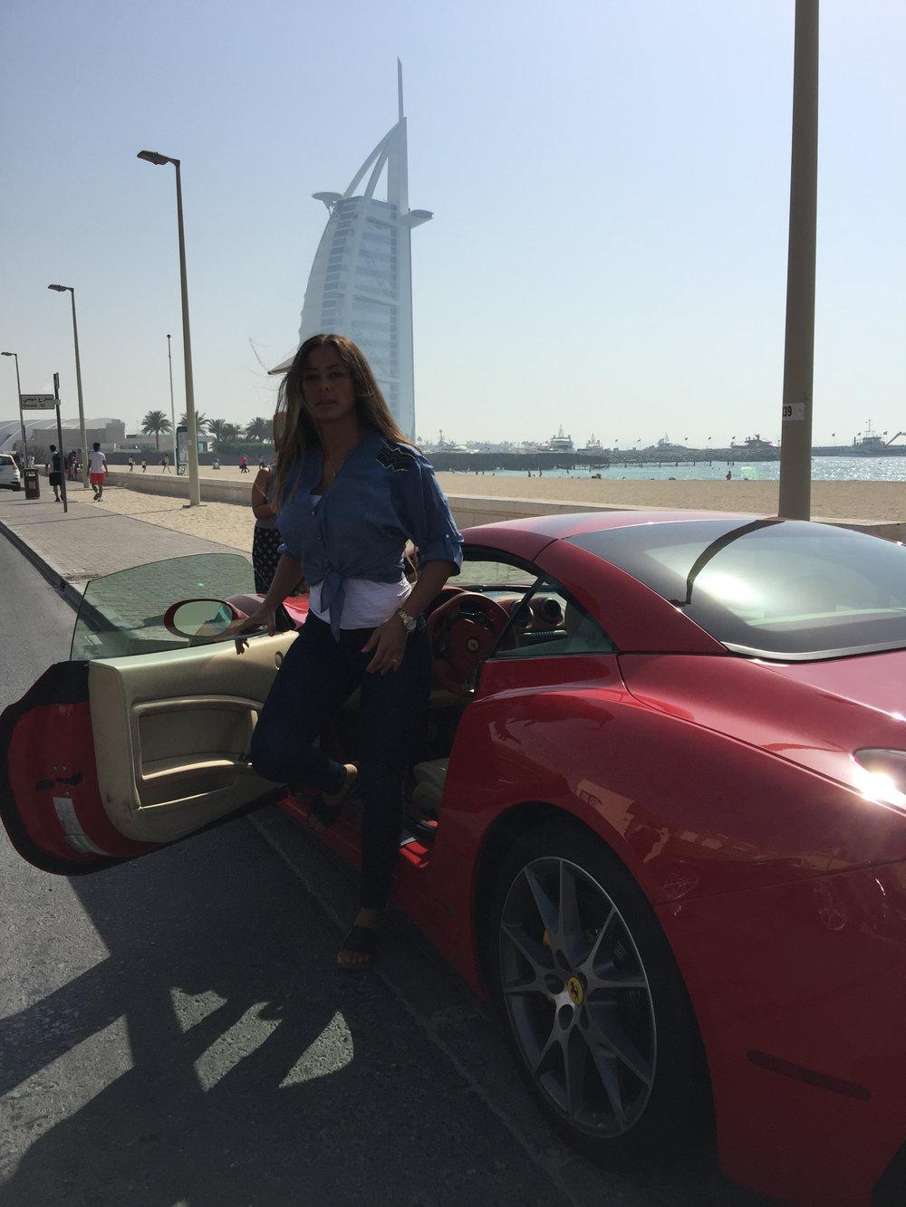 carla in her ferrari dubai burj khalifa room travel blogger influencer vlogger carla maria bruno advantures.jpg