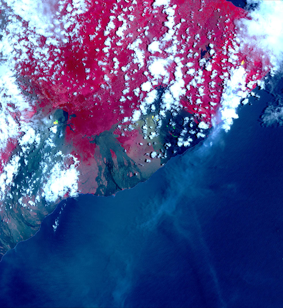 ASTER image acquired May 6 picks up hotspots on the thermal infrared bands – shown in yellow. These hotspots are newly formed fissures and lava flows. Credits: NASA/METI/AIST/Japan Space Systems, and U.S./Japan ASTER Science Team
