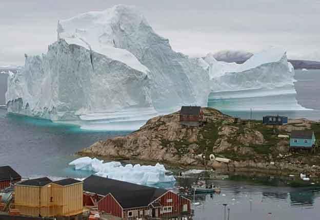 Residents in houses near the shore of Innarsuit, Greenland are prepared for an evacuation. (Magnus Kristensen/Ritzau Scanpix via AP)