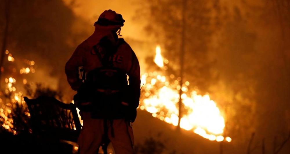 Fire fight battles wild fire in Northern California