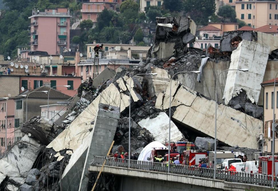 The collapsed Morandi Bridge is seen in the Italian port city of Genoa, Italy August 14, 2018. REUTERS/Stefano Rellandini