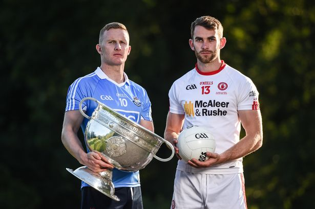 Ciarán Kilkenny of Dublin and Ronan McNamee of Tyrone with the Sam Maguire Cup (Image: Cody Glenn/Sportsfile)