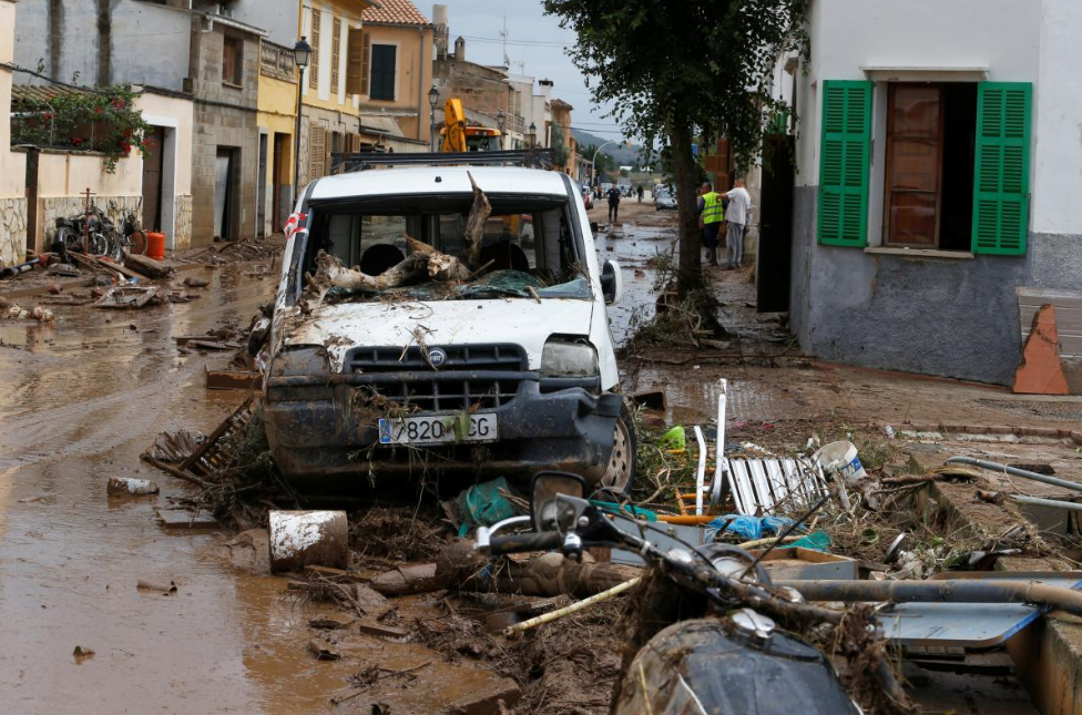 A destroyed car and debris are seen on the street as heavy rain and flash floods hit Sant Llorenc de Cardassar on the island of Mallorca, Spain, October 10, 2018. REUTERS/Enrique Calvo