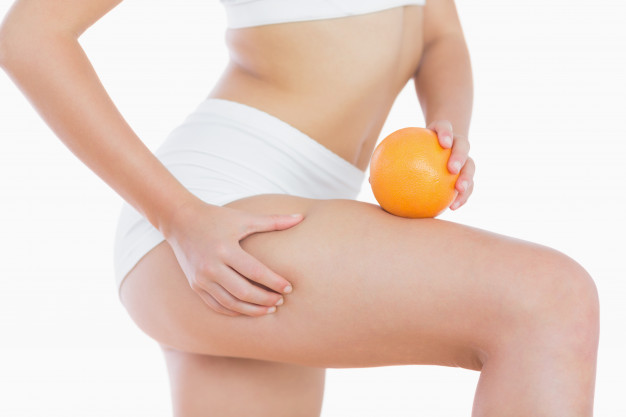 woman-squeezes-cellulite-skin-on-thigh-as-she-holds-orange_13339-956.jpg