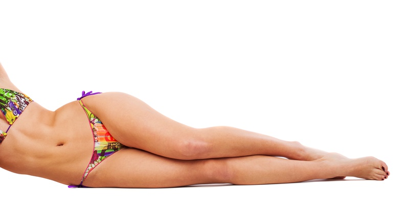 portrait of pretty girl wearing bikini on white background