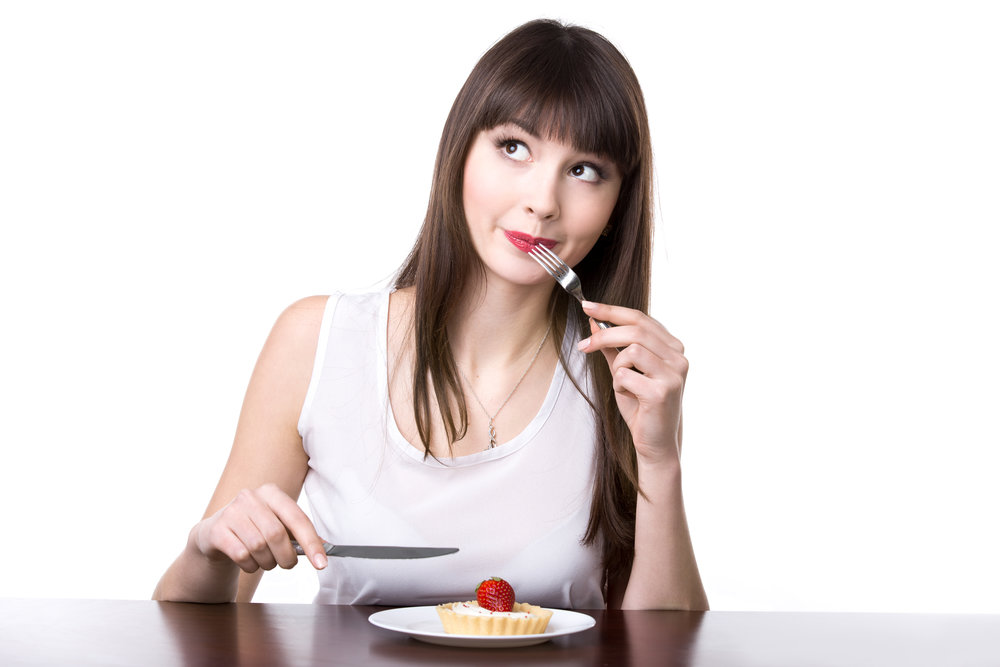 Young woman going to eat cake
