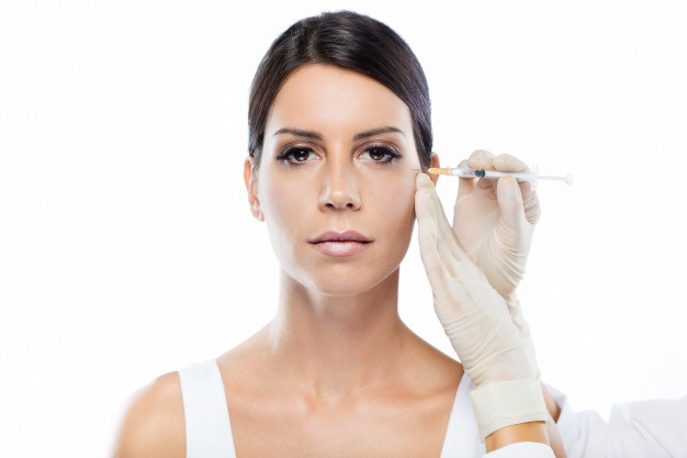 beautiful-young-woman-getting-botox-cosmetic-injection-her-face_1301-7523.jpg