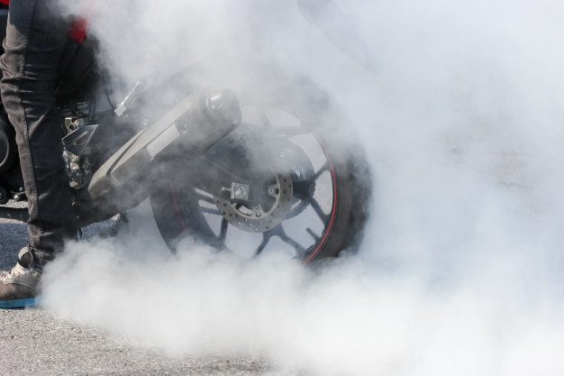 sport-motorbike-wheel-drifting-smoking-track-background-display_38810-1994.jpg
