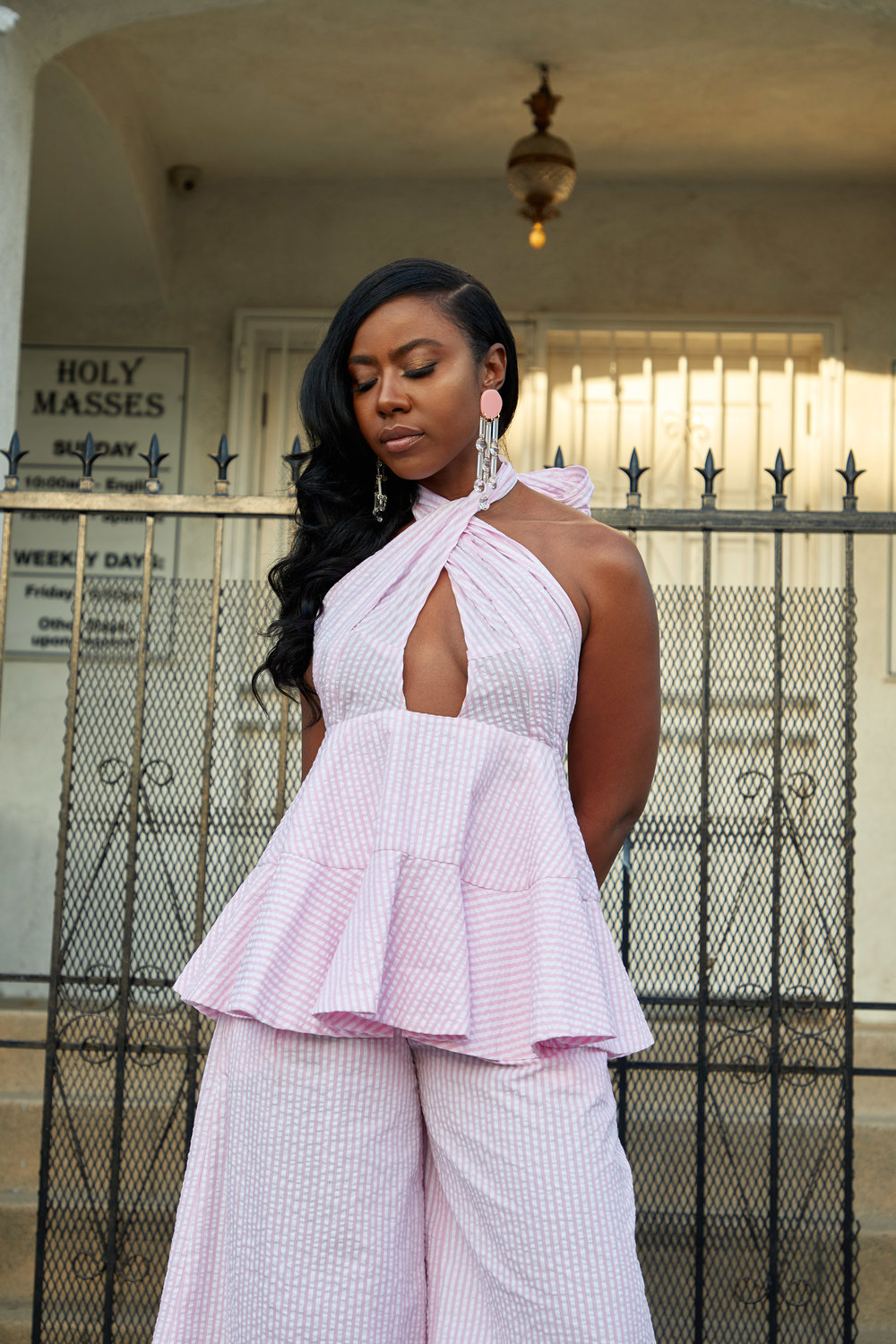 Nia is wearing a pink seersucker two piece by  Nika Tang  and earrings by  Melody Ehsani . Stylist:  Hema Persad
