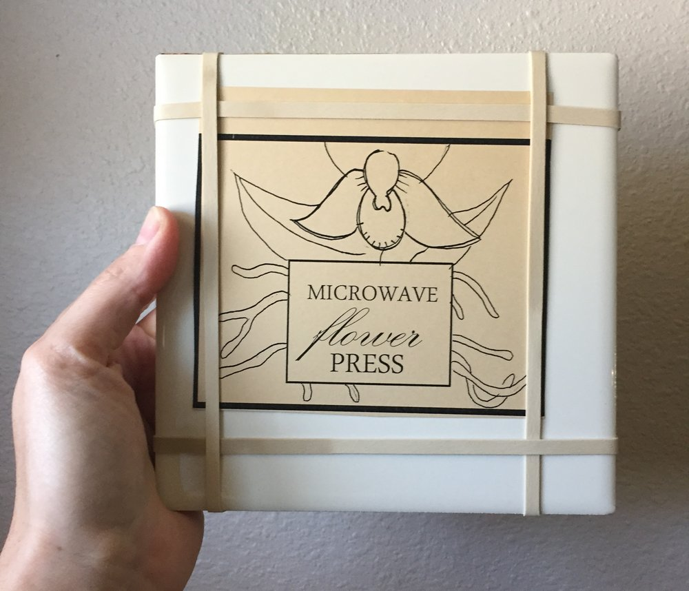 Yes! you can QUICKLY press flowers in the microwave with a microwave press.  It can press smaller flowers in 45 seconds with really lovely results. You can find this one at our site, includes instructions.
