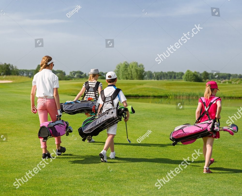 stock-photo-kids-walking-on-fairway-with-bags-at-golf-school-back-view-320449694.jpg