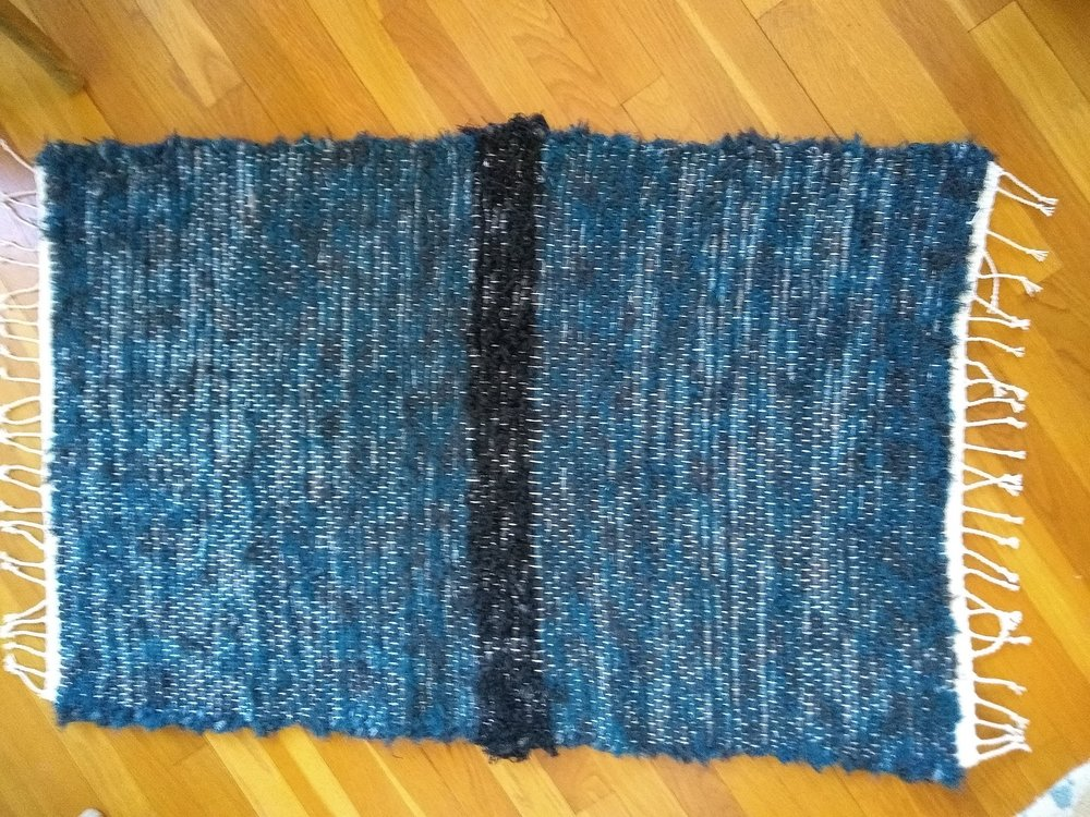 Finished 2' x 4' wool rug