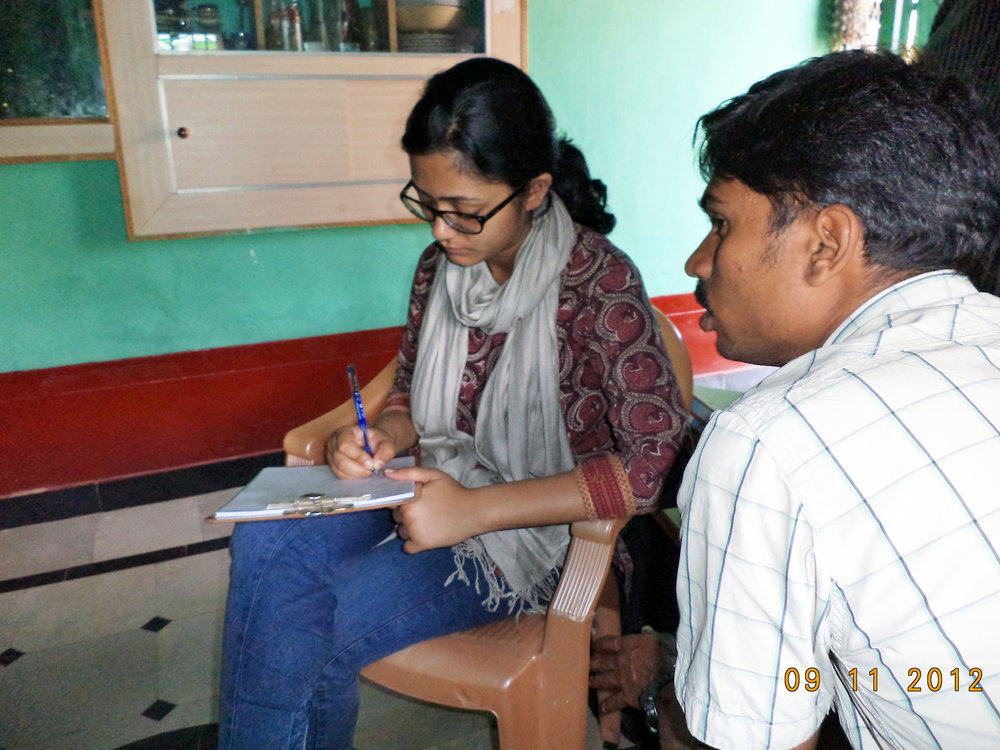 I interview villagers with the help of a translator in southern India
