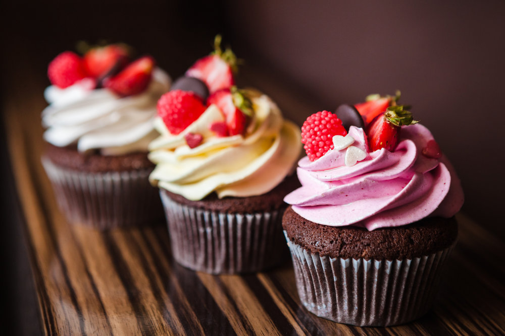 close up of chocolate cupcakes with berries.jpeg