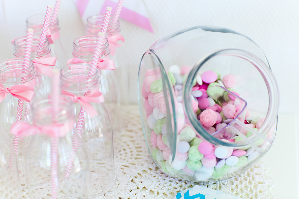TCP clear milk bottles and candy jar.jpeg