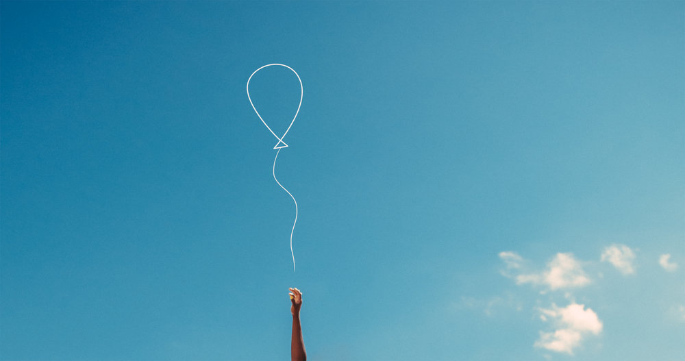 Womans Hand Reaching With Hope To Catch A Balloon Against Blue Sky.jpg