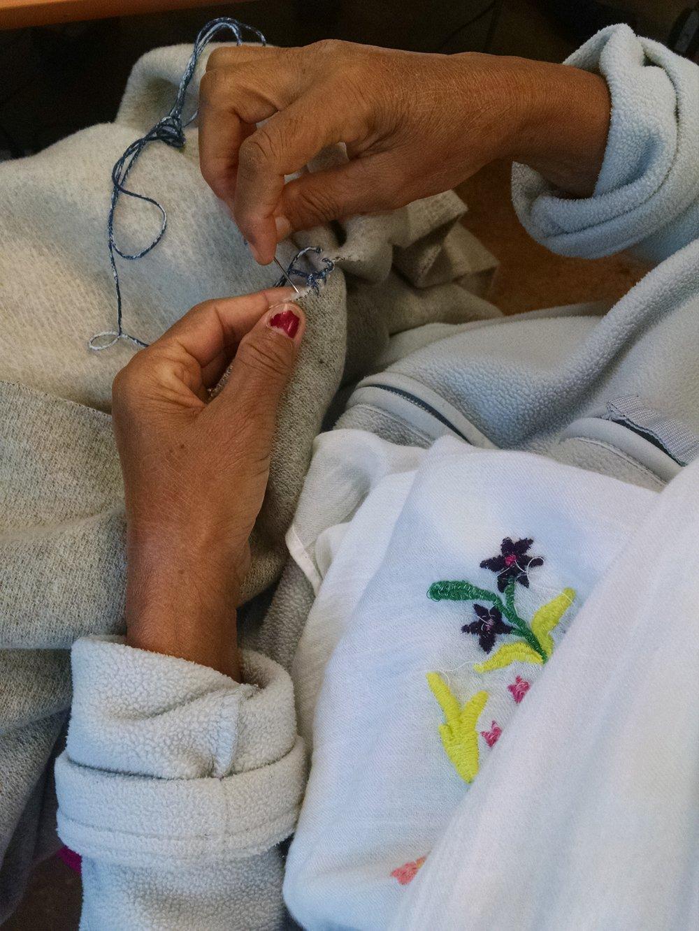 Alganesh hand sewing.jpg
