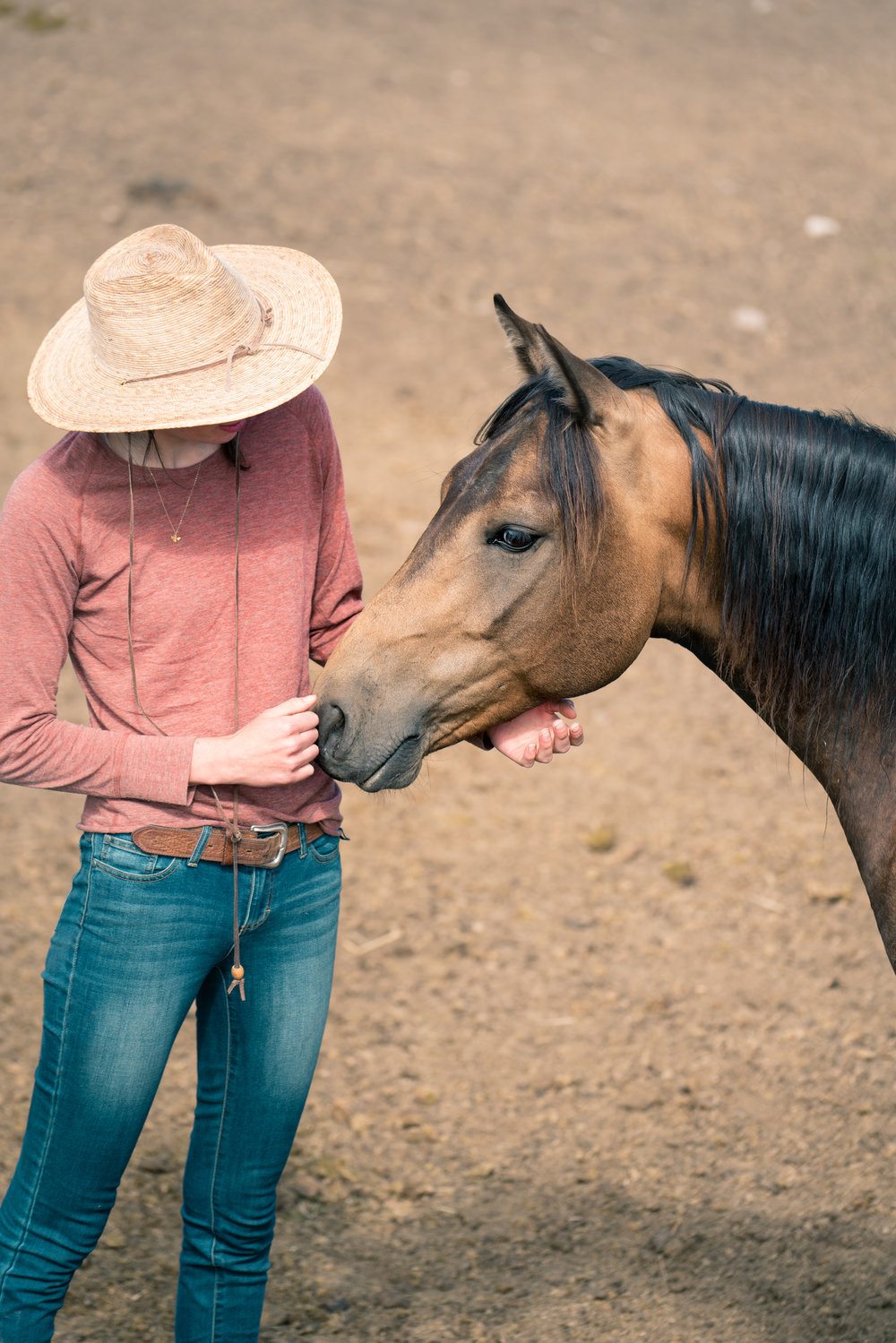 Melissa DiNino and horse in Montana's Centennial Valley.