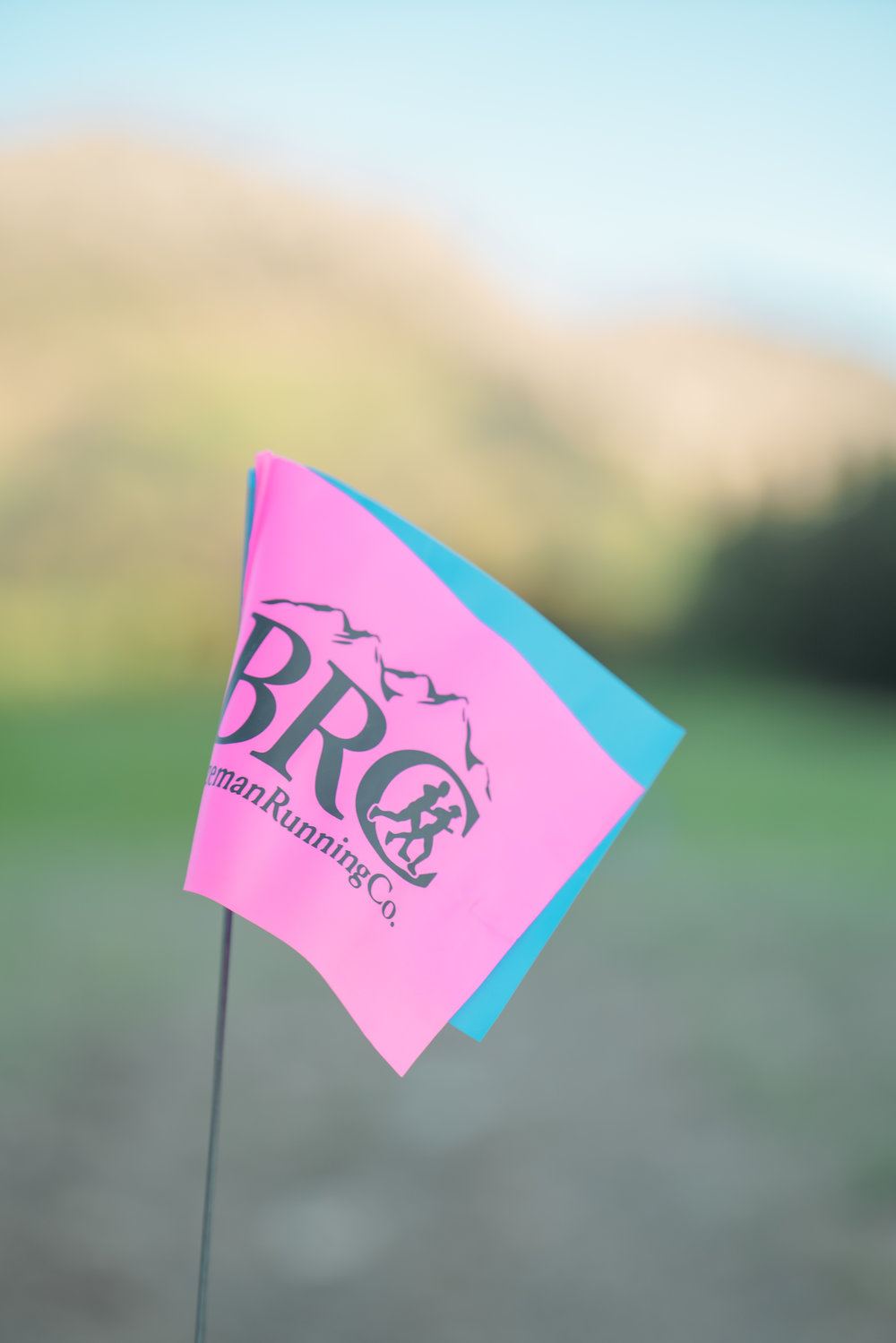 Bozeman Running Co. flags just before the racing of Crosscuts at Bridger Bowl just north of Bozeman, Montana.