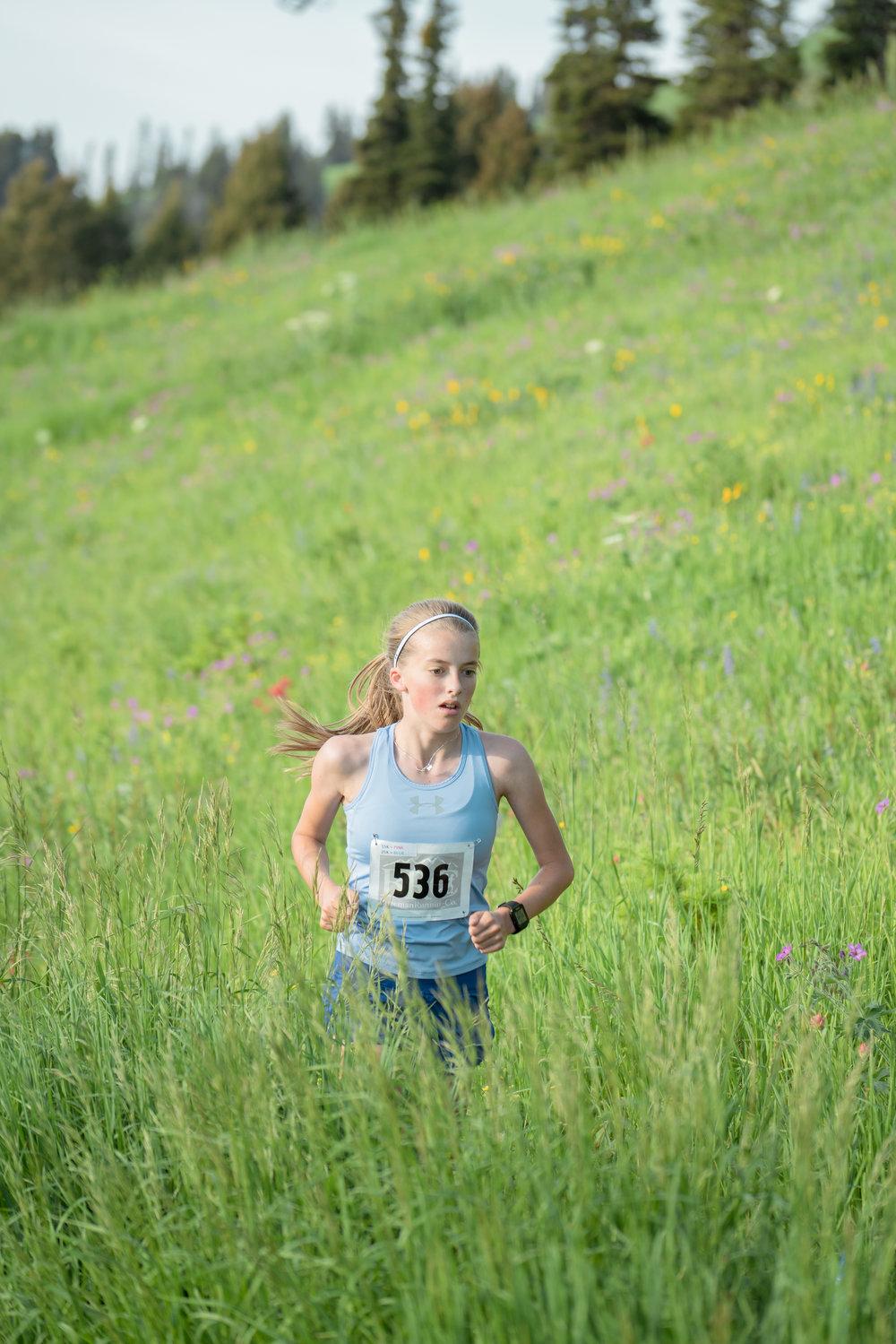 A young runner at Bozeman Running Co. racing of Crosscuts at Bridger Bowl just north of Bozeman, Montana.