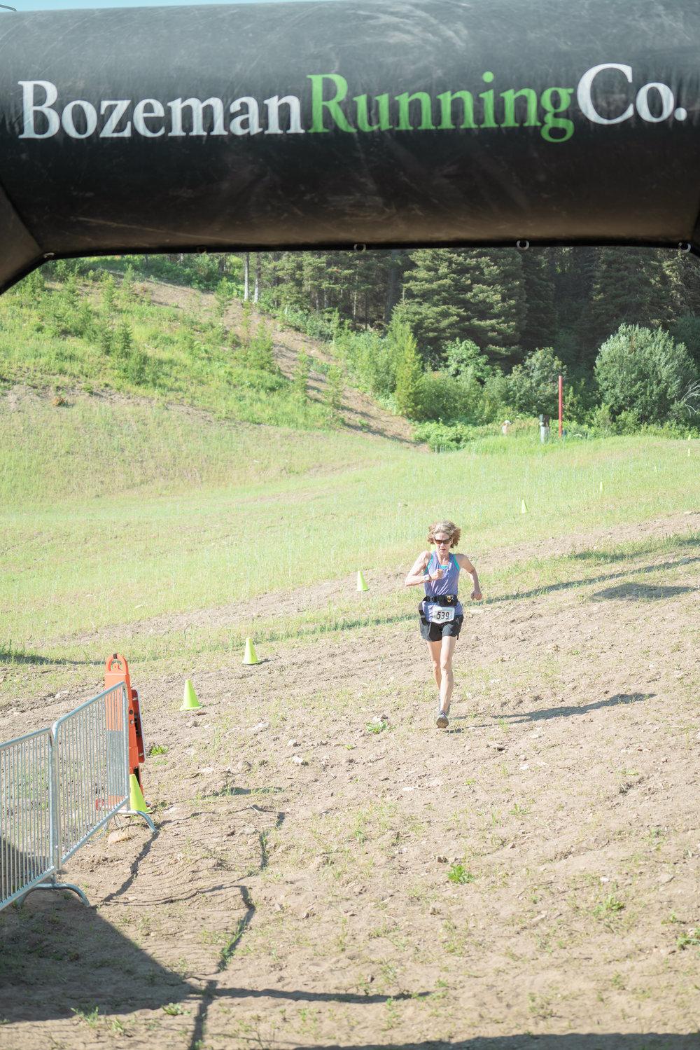 A runner finishing at Bozeman Running Co. racing of Crosscuts at Bridger Bowl just north of Bozeman, Montana.